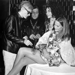 """Andy Warhol paints a butterfly on LTY's thigh (This event was recreated in """"Austin Powers: International Man of Mystery"""")"""